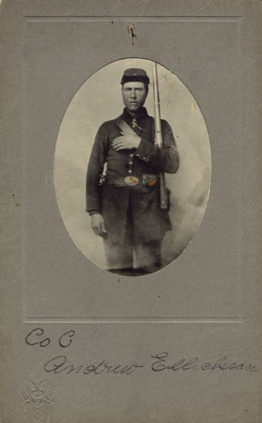 Three-quarter length oval studio portrait of Andrew Ellickson, a private of Company B, 15th Wisconsin Infantry, in uniform with bayonet sheathed on his side and holding his musket against his shoulder. The following information was obtained from the Regimental and Descriptive Rolls, Volume 20: He resided in Pleasant Springs, Wisconsin. On March 14, 1862, he enlisted and mustered into service at Madison, Wisconsin on December 02, 1861, at the age of 22. He was captured during the Battle of Chickamauga on September 19, 1863, and returned to Company B on November 19, 1863, as a paroled prisoner of war. On January 1, 1865, he was transferred to Company H and temporary attached to the 24th Wisconsin Infantry. Ellickson was then transferred to Company I, 13th Wisconsin Infantry on June 10, 1865, at Nashville, Tennessee as a paroled prisoner.