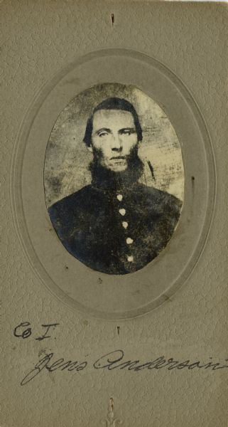 Head and shoulders oval portrait of Jens Anderson, a private in Company I, Wisconsin 15 Infantry. The following information was obtained from the Regimental and Descriptive Rolls, Volume 20: He held residence in Chippewa, Wisconsin. On December 14, 1861, he enlisted and was mustered into service on February 12, 1861, in Madison, Wisconsin at the age of 18. He survived the war and was mustered out of service on February 10, 1865, at Chattanooga, Tennessee.