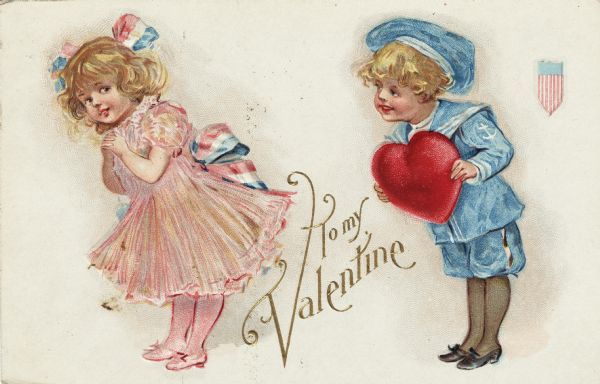 "Valentine's Day postcard featuring a girl and a boy. The girl, wearing a pink dress, stockings and shoes, with a red, white and blue sash and hair ribbon, is leaning forward while glancing back shyly. The boy, wearing a blue and white sailor suit, leans towards her while holding a large red heart. In the upper right corner is the federal shield of the United States. Between the children is the text, ""To My Valentine"". Chromolithograph, embossed."