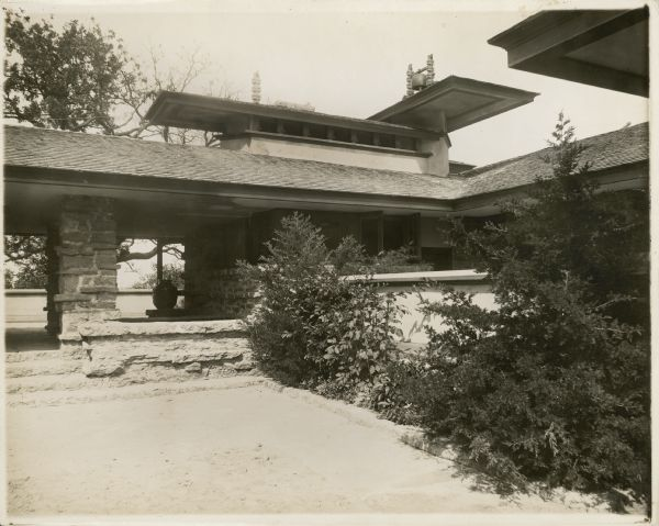 Entrance loggia and kitchen windows from the courtyard near the porte-cochere of Taliesin II.