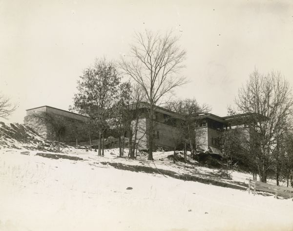 Southeast elevation of Taliesin I, Winter 1911-1912. Construction debris is scattered around the base of the building.
