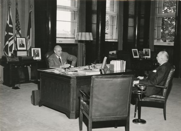 John J. McCoy, U.S. Commissioner in Germany being interviewed by Mutual news analyst Cecil Brown. Brown made his reputation during the post-World War II years with his interviews of world leaders.