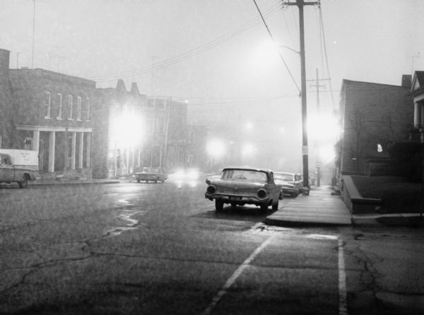 """Fog blanketed the town on a summer evening."""