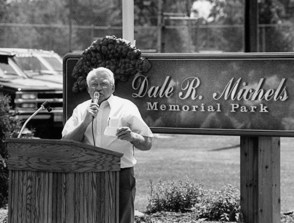"""The Brownsville Village President, Ron Sabel, speaks at the dedication of Dale R. Michels Memorial Park."""