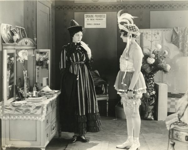 "In a backstage dressing room, the straight-laced and innocent Justine Spencer (played by Irene Castle) is shocked to find that her mother (Augusta Anderson) is Dodo, a vaudeville performer, in a scene still from early in the silent film ""The Amateur Wife"" (Lasky 1920)."