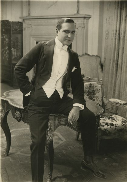 "Earle Williams wears a white tie and tails for the title role in ""Arsene Lupin."""
