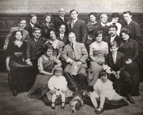 Group photograph of the Essanay Eastern Stock Company in Chicago, Illinois, 1911: Top row, left to right: Joseph Dailey, F. Doolittle, Inez Callahan, William J. Murray, Curtis Cooksey, Helen Lowe, Howard Missimer, Miss Lavalliet, Cyril Raymond. Middle row: Florence Hoffman, Harry Cashman, Alice Donovan, Frank Dayton, Harry McRae Webster (producer/director), Lottie Briscoe (leads), William C. Walters, Rose Evans. Bottom row: Eva Prout (Evebelle Ross Prout), Bobbie Guhl, Jack Essanay (dog), Charlotte Vacher, Tommy Shirley (Thomas P. Shirley).