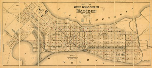 "City water works system map. Pencil annotation on the top right reads: ""Period represented is after 1887 and before Aug. 1891"". The middle of the map has a key and reads: ""PROJECTED LINES IN RED. PRESSURE AT HYDRANT IN RED FIGURES."""