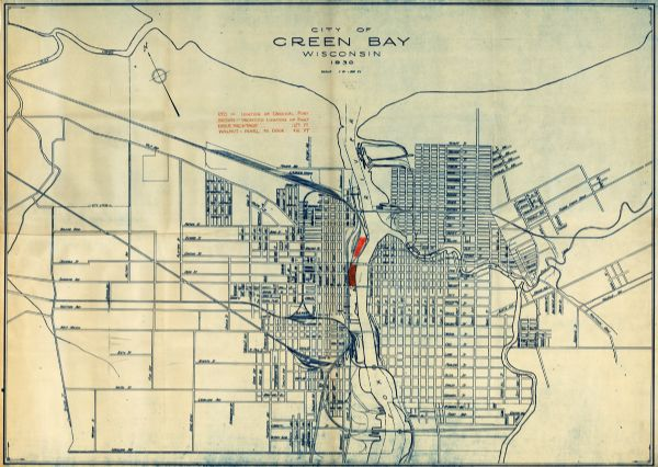 This map shows a plat of the town, local streets, railroads, creeks, part of Fox River, and part of the bay of Green Bay. The location of the original fort is in red and the proposed location of fort in brown.