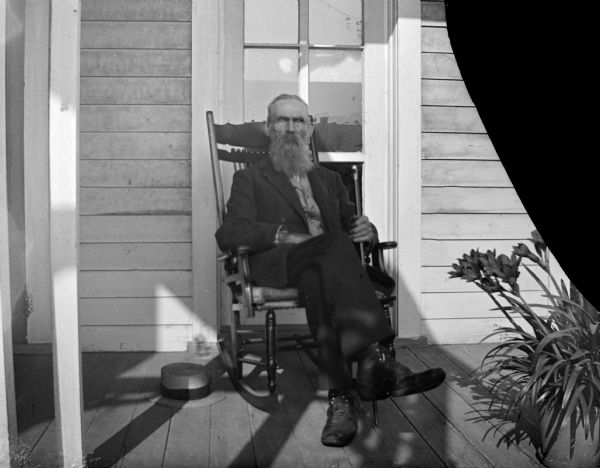 Bearded Man on a Porch | Photograph | Wisconsin Historical Society