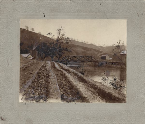 rutted road and bridge over river photograph wisconsin