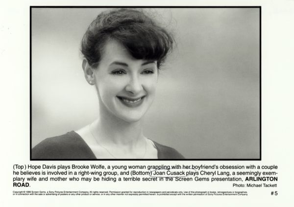 Publicity photograph of Joan Cusack for the film <i>Arlington Road</i>.  She is smiling and has her hair up.