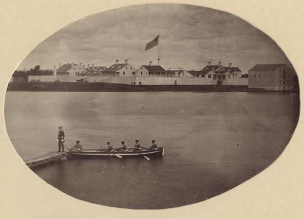 A rare photograph of U.S. Army soldiers stationed at Fort Howard rowing a boat on the Fox River. Fort Howard, built in 1816, was the first in the chain of forts stretching from Fort Winnebago (at Portage) and Fort Crawford at Prairie du Chien in order to protect the early Wisconsin frontier. Because of unhealthy conditions a new fort was built on higher ground. Two years after this photograph was taken, the Fort Howard was decommissioned. Several of its original buildings have been preserved at Heritage Hill State Historical Park.