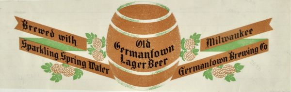 "Label for Old Germantown Lager Beer, made by the Germantown Brewing Company. The Label features a barrel of beer, surrounded by flowering plants, probably hops, and banners with the company name. Also printed on the label is ""Brewed with Sparkling Spring Water."""