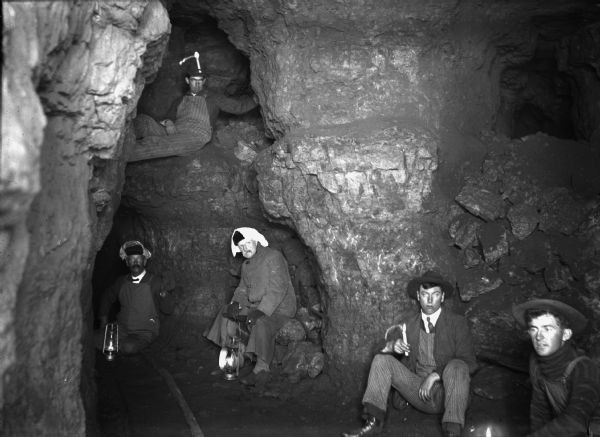 Miners in the bowels of a lead mine.