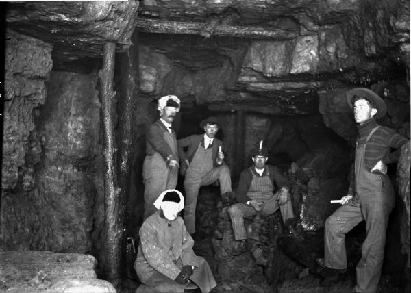 Five miners inside a lead mine.