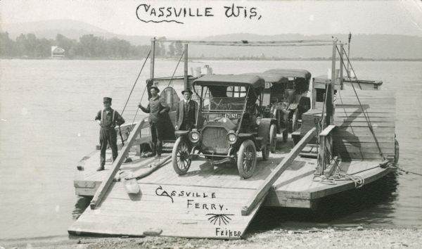 The Cassville Ferry with three cars and passengers, crossing the Mississippi River from Cassville to Turkey River, Iowa.