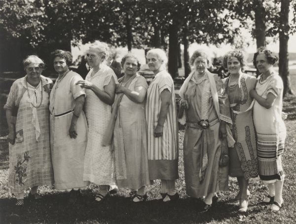 Group of eight women, probably members of a club, in Vilas Park.