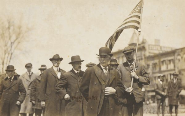 Detail of a group of civilian men in the Loyalty Day parade.