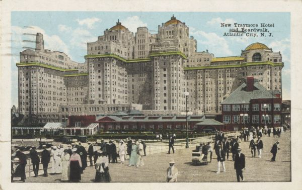 Commercial postcard with slightly elevated view of people on the boardwalk at Atlantic City with the Traymore Hotel in the background. Postmarked from Atlantic City, July 2, 1919. Addressed to: Miss Marion Strong, Antigo, Wis.