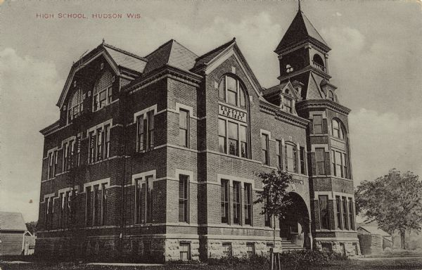 "Exterior view from street towards the high school. A date stone above a second floor window reads: ""Erected A.D. 1887."""