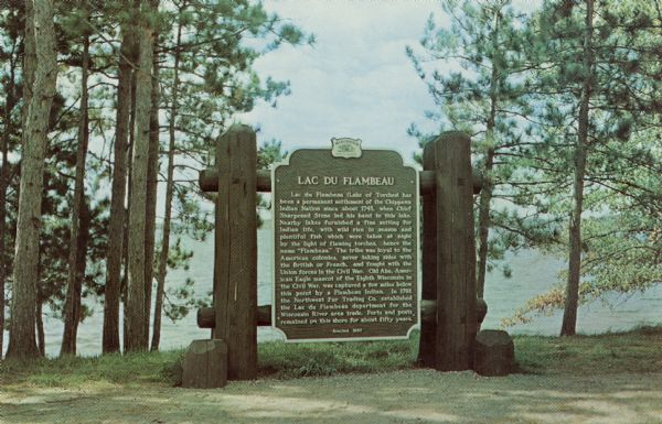 Historical marker on the shore of Flambeau Lake. Erected 1937.