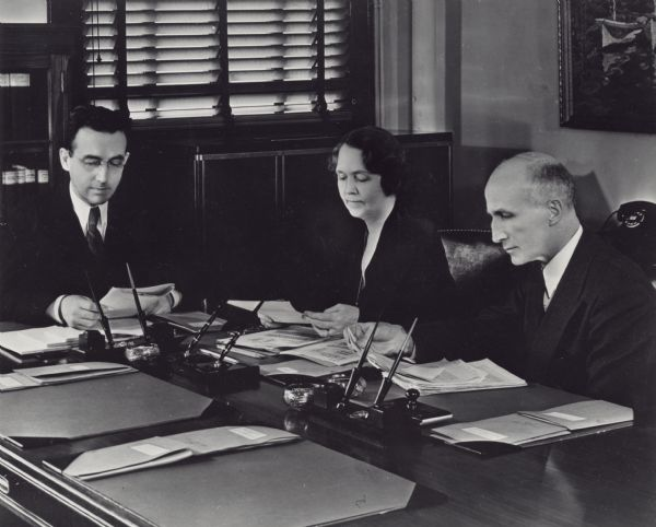 Arthur Altmeyer, Ellen Woodward and George Bigge in an early meeting of the Social Security Board.