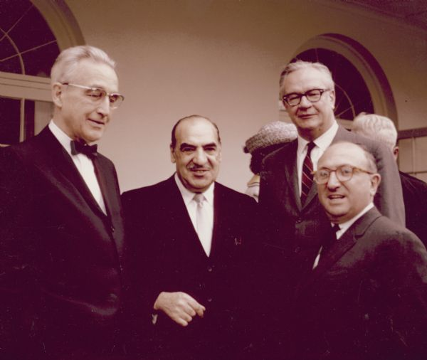 Four men, all administrators at the Social Security office, celebrating at the 20 millionth beneficiary party. They are, from left to right, Arthur Altmeyer, Anthony Celebrezze, Robert M. Ball, Commissioner of Social Security, and Wilbur J. Cohen.