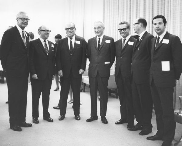 Group of men posing at a ceremony celebrating the 33rd anniversary of the Social Security bill. From left to right: Commissioner of Social Security, Robert Ball; Secretary of Health, Education and Welfare, Wilbur Cohen; Dr. Ignacio Morones-Prieto, Director, Mexican Social Security System and President, Inter-American Social Security Permanent Committee; Dr. Arthur Altmeyer; Dr. Gaston Novello, Mexico, Secretary General, Inter-American Social Security Permanent Committee; Berryl Frank, Organization of American States; Dr. Luis Garcia Cardenas, Technical Advisor.