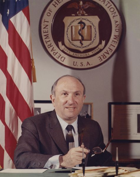 Portrait of Wilbur J. Cohen sitting at his desk as Secretary of Health, Education and Welfare. Social Security Administration was his responsibility.