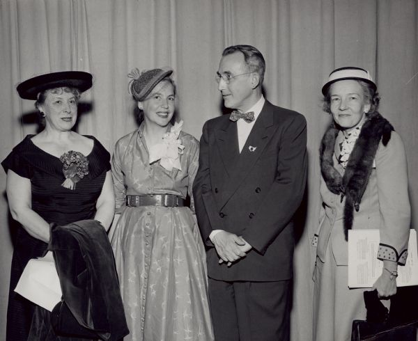 Elizabeth Wickenden, standing to the left of Arthur Altmeyer, was a social welfare and Social Security policy consultant, analyst, and writer, and professor of public policy and urban studies. Two women are unidentified.<p>She was a member of the federal Advisory Council on Public Welfare during the 1960s and President Kennedy's Task Force on Health and Social Security Legislation (1960-1961). As a consultant on public social policy, Wickenden analyzed and interpreted policy and legislation, studied problems, helped formulate goals and strategies, and promoted social action.<p>In 1978 she took on a leading role in the Study Group on Social Security and the Save Our Security Coalition.