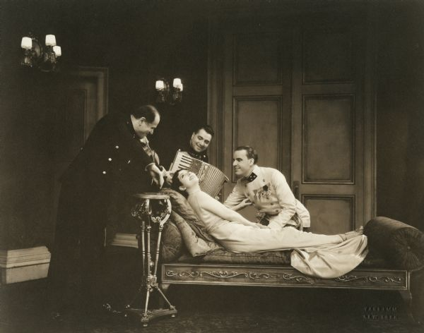 "Lynn Fontanne and Alfred Lunt in a scene from ""Reunion in Vienna."""