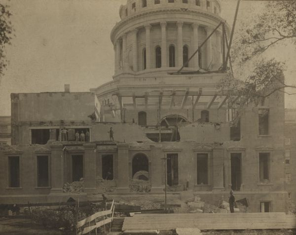 Men working on the reconstruction of the fourth Wisconsin State Capitol (third in Madison) after the 1904 fire.