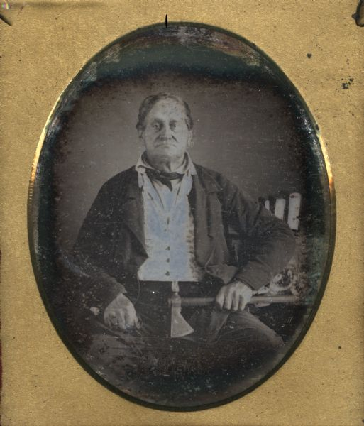 Sixth plate daguerreotype studio portrait of Augustin Grignon. He is seated, holding a tomahawk. The tomahawk, which could also be used as a pipe, was made from a gun barrel by Joseph Jourdain, the government blacksmith in Green Bay. Grignon was a fur trader and settler in Green Bay.