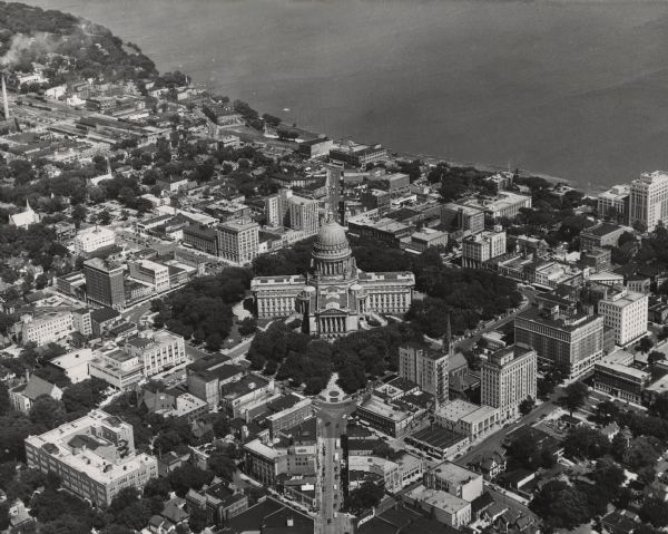 Aerial view of the Wisconsin State Capitol building and surrounding Madison area. Lake Monona is in the background.