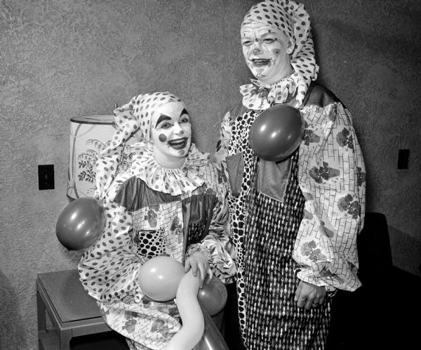 "James and Sheila Reul dress in clown costumes at the ""Mardi Gras"" dancing party of the Chameleon Club at the Nakoma Country Club."