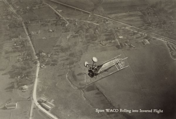 Aerial view of a WACO ATO (also known as 10-T Taperwing) rolling into inverted flight. The airplane is powered by a 220hp Wright J-5 motor.
