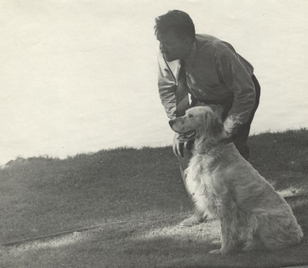 Sid Boyum with Duke, the golden retriever at his side.