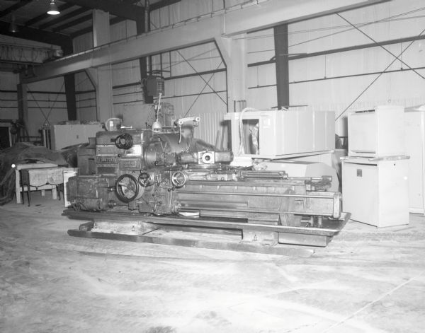 A large machine indoors at the Gisholt factory.