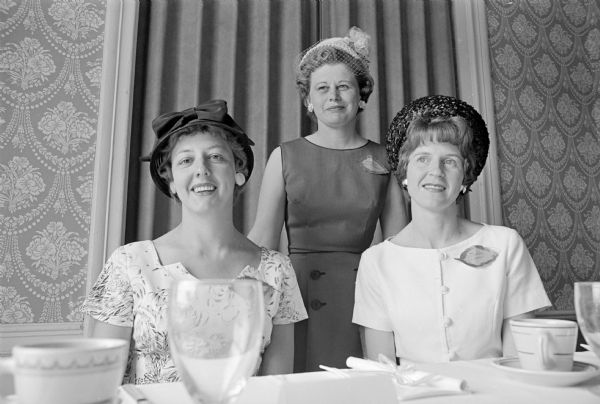 Who's New club wound up its season with a luncheon at Maple bluff Country Club. Pictured L to R: Marles Christoph; Virginia Schomberg; and Constance Lamp. Each woman is wearing a leaf-shaped name tag.