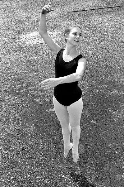 Mimi Pansley (?) of McFarland shown performing a sauté, a sample elevation in ballet. The demonstrations were to show how ballet is basic for all forms of athletic competition.