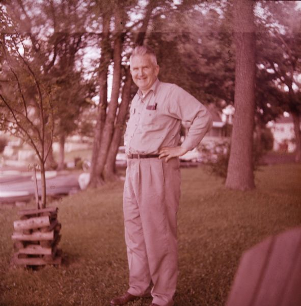Sid standing on a lawn outdoors wearing khakis.
