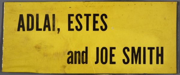 "A bumper sticker with black text on a yellow background that reads: ""Adlai, Estes and Joe Smith."""