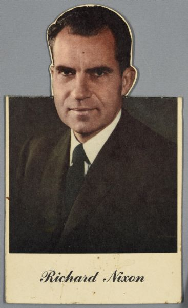 Table card, shown folded, with a waist-up portrait of Richard Nixon with his name printed below.