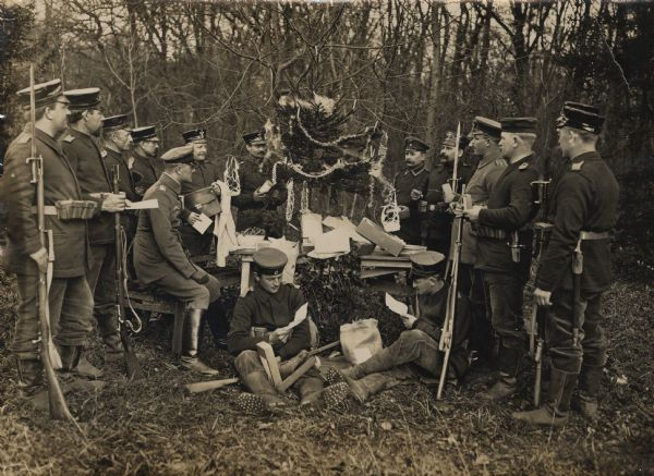 German reservists maintain a semblance of home while at war as they exchange gifts in front of a Christmas tree.