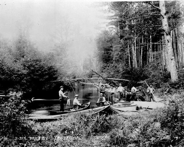 Eight men trout fishing on the Brule River.