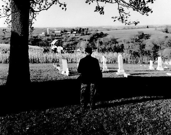 Charles Green, the last survivor of the African American colony at Pleasant Ridge (near Lancaster, WI) looks out over the community graveyard.