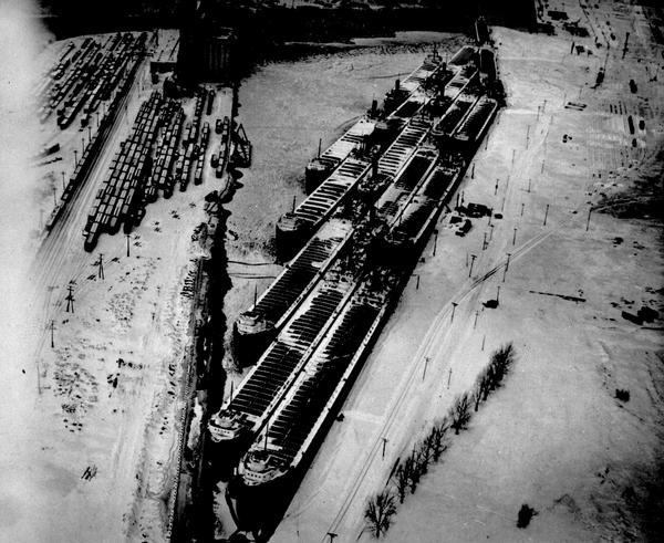 Overhead view of ships tied up for the winter in slips.
