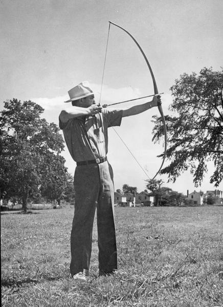 Man holding bow during archery practice.