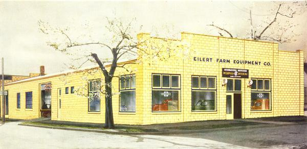 "The front of the Eilert Farm Equipment Company, an International Harvester dealership. The image appeared on the cover of a brochure titled the ""McCormick-Deering Standard Store Plan."""